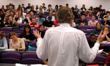 teacher-in-front-of-students-in-lecture-hall